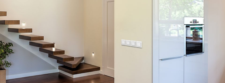 Luxurious glass light switches by Luminosa in a modern home